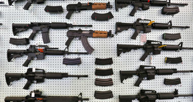 In this July 20, 2014 file photo, guns are displayed for sale by an arms seller east of Colorado Springs, Colo.