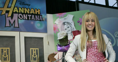 "this June 19, 2007 file photo Miley Cyrus, star of The Disney Channel's series ""Hannah Montana"" makes an appearance at the Licensing International Expo in New York."