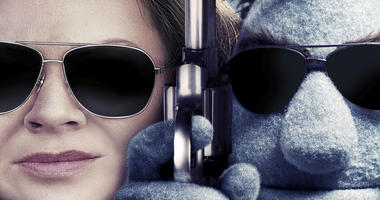 """Detail from poster art for """"The Happytime Murders,"""" a film starring Melissa McCarthy."""