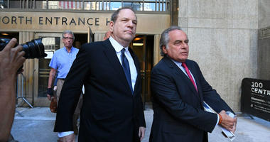Harvey Weinstein leaves court with his lawyer, Ben Brafman.