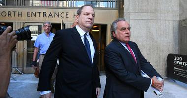 Harvey Weinstein leaves court with his lawyer, Ben Brafman.