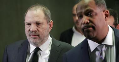 Harvey Weinstein, left, leaves court with attorney Ron Sullivan, Friday, Jan. 25, 2019, in New York.