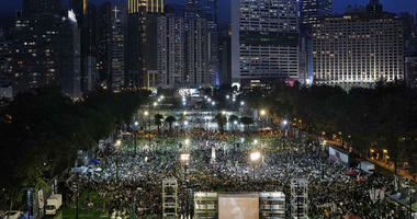 Thousands of people attend a candlelight vigil for victims of the Chinese government's brutal military crackdown three decades ago on protesters in Beijing's Tiananmen Square at Victoria Park in Hong Kong Tuesday, June 4, 2019.