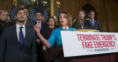 House Speaker Nancy Pelosi of Calif., accompanied by Rep. Joaquin Castro, D-Texas, left, and others, speaks about a resolution to block President Donald Trump's emergency border security declaration on Capitol Hill, Monday, Feb. 25, 2019 in Washington.