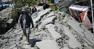 A man walks on a heavily damaged street due to the earthquake in Balaroa neighborhood in Palu, Central Sulawesi, Indonesia Indonesia, Tuesday, Oct. 2, 2018.