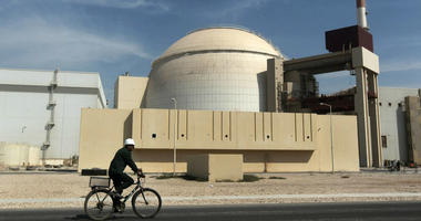 In this Oct. 26, 2010 file photograph, a worker rides a bicycle in front of the reactor building of the Bushehr nuclear power plant, just outside the southern city of Bushehr.