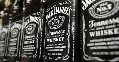 In this Dec. 5, 2011, file photo, bottles of Jack Daniel's Tennessee Whiskey line the shelves of a liquor outlet in Montpelier, Vt.