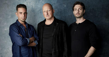 """Wade Robson, from left, director Dan Reed and James Safechuck pose for a portrait to promote the film """"Leaving Neverland"""" at the Salesforce Music Lodge during the Sundance Film Festival on Thursday, Jan. 24, 2019, in Park City, Utah."""
