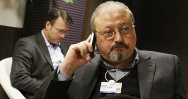 In this Jan. 29, 2011 file photo, Saudi journalist Jamal Khashoggi speaks on his cellphone at the World Economic Forum in Davos, Switzerland.