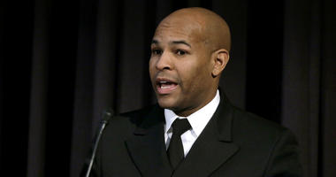 United States Surgeon General Jerome Adams addresses an audience during a national summit focused on police efforts to address the opioid epidemic at Harvard Medical School in Boston.