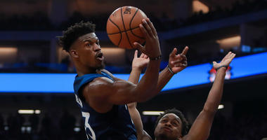 Minnesota Timberwolves guard Jimmy Butler (23) passes the ball against Sacramento Kings guard Yogi Ferrell (3) during the second quarter at Golden 1 Center.