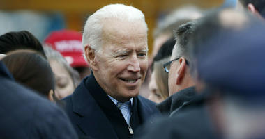 Former vice president Joe Biden talks with officials after speaking at a rally in support of striking Stop & Shop workers in Boston, Thursday, April 18, 2019.