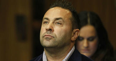 "In this Oct. 15, 2014 file photo, Giuseppe ""Joe"" Giudice, from the television show ""Real Housewives of New Jersey"", stands during a hearing in the Passaic County Courthouse in Paterson, N.J."