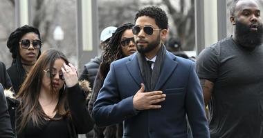 Empire actor Jussie Smollett, center, arrives at the Leighton Criminal Court Building for his hearing on Thursday, March 14, 2019, in Chicago.