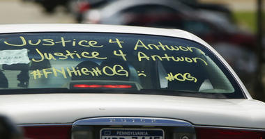 One of the vehicles in the funeral procession for Antwon Rose Jr. has a message displayed as it arrives at the Woodland Hills Intermediate school on Monday, June 25, 2018, in Swissvale, Pa.
