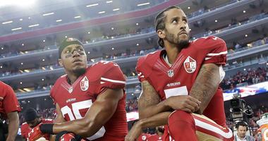 San Francisco 49ers safety Eric Reid (35) and quarterback Colin Kaepernick (7)
