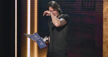 Keith Urban wipes away tears as he accepts the award for entertainer of the year at the 52nd annual CMA Awards at Bridgestone Arena on Wednesday, Nov. 14, 2018, in Nashville, Tenn.