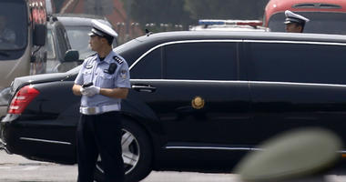 The motorcade that is believed be carrying North Korea leader Kim Jong Un, passes by policemen as it leaves the Beijing Capital International Airport in Beijing, Tuesday, June 19, 2018.
