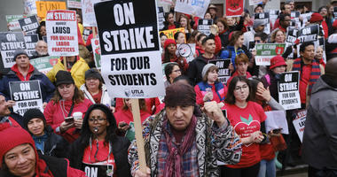 Actor, musician and activist, Steven Van Zandt, center, supports striking teachers on the picket in front of Hamilton High School in Los Angeles on Wednesday, Jan. 16, 2019.