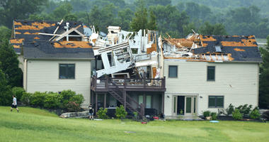 A destroyed home sits in a neighborhood after it was hit by a tornado on Tuesday, May 28, 2019, south of Lawrence, Kan., near US-59 highway and N. 1000 Road.