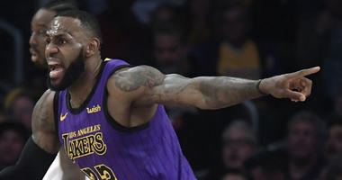Los Angeles Lakers forward LeBron James, left, reacts to an inadvertent whistle by a referee as Portland Trail Blazers center Jusuf Nurkic watches during the first half of an NBA basketball game Wednesday, Nov. 14, 2018, in Los Angeles.