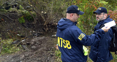 Members of the National Transportation Safety Board work at the scene of yesterday's fatal crash, in Schoharie, N.Y., Sunday, Oct. 7, 2018.