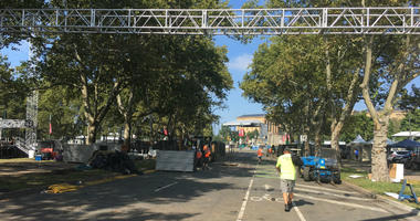 Clean-up crews try to put the Benjamin Franklin Parkway back in order after Made in American 2018.