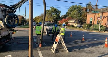 Crews from Pennsylvania American Water dig in the street on Township Line Road near Dekalb Pike in Whitpain Township, Montgomery County, the site of an overnight water main break.