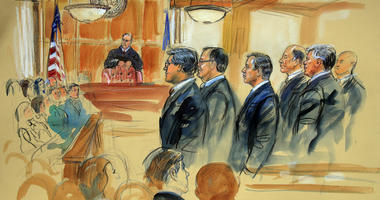 This courtroom sketch depicts Paul Manafort, fourth from right, standing with his lawyers in front of U.S. district Judge T.S. Ellis III and the selected jury during the jury selection of his trial at the Alexandria Federal Courthouse in Alexandria, Va.