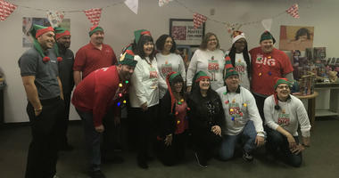 Workers at Mattress Firm collect Christmas toys for foster kids.