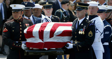 A military honor guard carries the casket of Sen. John McCain, R-Ariz., after a memorial service at North Phoenix Baptist Church Thursday, Aug. 30, 2018, in Phoenix.