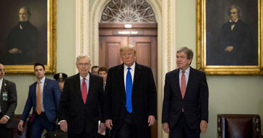 President Donald Trump accompanied by Senate Majority Leader Mitch McConnell of Ky., left, and Sen. Roy Blunt, R-Mo., right, arrives for a Senate Republican policy lunch on Capitol Hill in Washington, Tuesday, March 26, 2019.