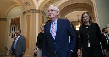 Senate Majority Leader Mitch McConnell, R-Ky., walks to the chamber for the final vote to confirm Supreme Court nominee Brett Kavanaugh, at the Capitol in Washington, Saturday, Oct. 6, 2018.