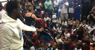 Meek Mill was back at his old elementary school to give out $6,000 worth of book bags and other school supplies.