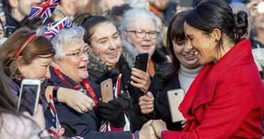 Meghan, Duchess of Sussex speaks with members of the public during a walkabout of Hamilton Square as part of a visit to a new sculpture marking the 100th anniversary of war poet Wilfred Owen's death, in Birkenhead, northwest England, Monday, Jan. 14, 2019