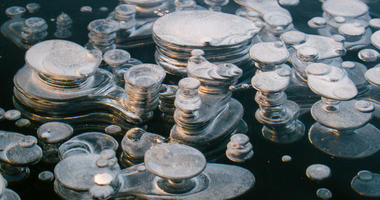 Methane bubble in the ice a of a freshly frozen Paezeriai lake in Lithuania