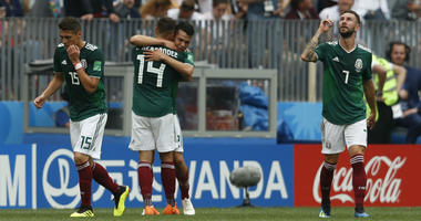 Mexico players celebrate a goal by Mexico's Hirving Lozano, center right, during the group F match between Germany and Mexico at the 2018 soccer World Cup in the Luzhniki Stadium in Moscow, Russia, Sunday, June 17, 2018.