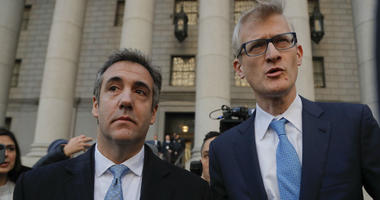 Michael Cohen, left, walks out of federal court with his attorney Guy Petrillo, Thursday, Nov. 29, 2018, in New York.