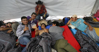 Central American migrants, part of a caravan hoping to reach the U.S. gets settled in a shelter at the Jesus Martinez stadium, in Mexico City, Monday, Nov. 5, 2018.
