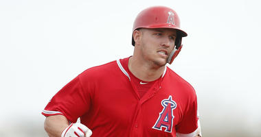 Los Angeles Angels center fielder Mike Trout (27) runs to third base after hitting a triple against the Los Angeles Dodgers in the first inning at Tempe Diablo Stadium.