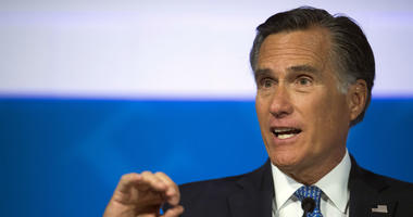 This Oct. 9, 2018, file photo shows Republican U.S. Senate candidate Mitt Romney answering a question about tariffs during the debate with Democratic opponent Jenny Wilson in the America First Event Center in Cedar City, Utah.