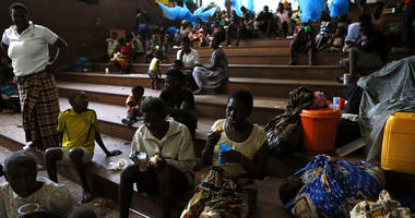 Displaced families, victims of Cyclone Idai, eat lunch at the Samora Machel Secondary School which is being used to house victims of the floods in Beira, Mozambique, Sunday March 24, 2019.