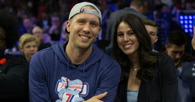 Philadelphia Eagles quarterback Nick Foles and his wife Tori Moore Foles look on during the third quarter in game three of the second round of the 2018 NBA Playoffs between the Philadelphia 76ers and the Boston Celtics at Wells Fargo Center.