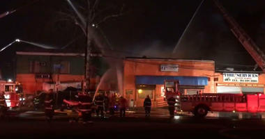 The Philadelphia Fire Department is battling a fire at a North Philadelphia auto body shop.