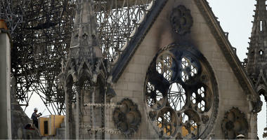A worker checks on a wooden support structure placed on the Notre Dame Cathedral in Paris, Wednesday, April 17, 2019.