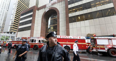 New York City Police and Fire Department personnel secure the scene in front of a building in midtown Manhattan where a helicopter crash landed, Monday, June 10, 2019.