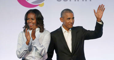 In this Oct. 31, 2017, file photo, former President Barack Obama, right, and former first lady Michelle Obama appear at the Obama Foundation Summit in Chicago.