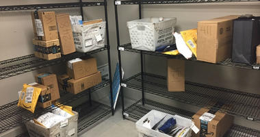 In this April 13, 2018, file photo, packages from Internet retailers are delivered with the U.S. Mail in a apartment building mail room in Washington.