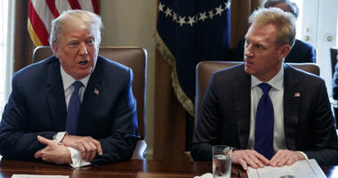 In this April 9, 2018, file photo, Deputy Secretary of Defense Patrick Shanahan, right, listen as President Donald Trump speaks during a cabinet meeting at the White House, in Washington.