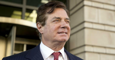 In this Thursday, Nov. 2, 2017, file photo, Paul Manafort, President Donald Trump's former campaign chairman, leaves Federal District Court, in Washington.